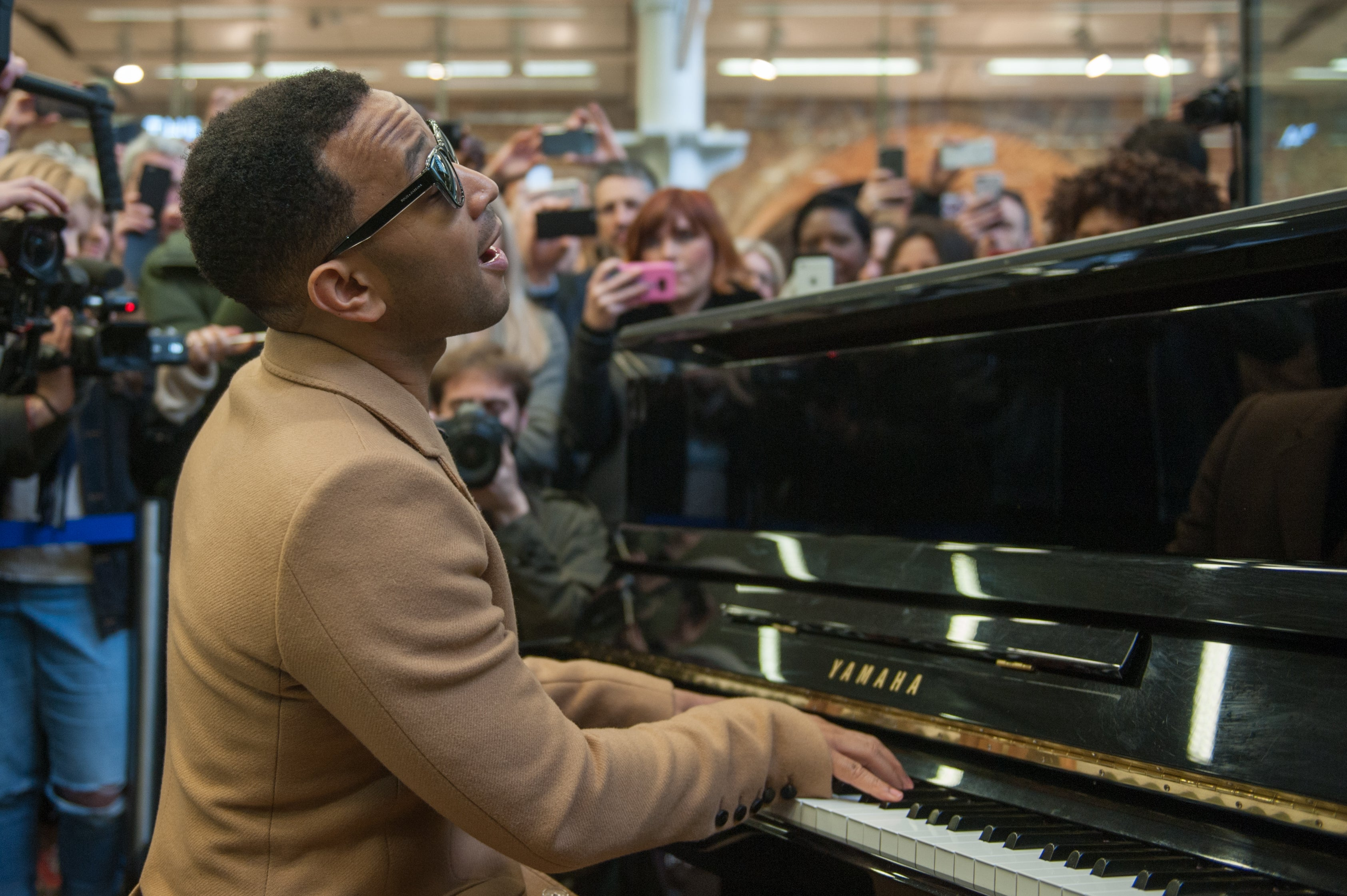 John Legend Turns Up At St Pancras, Drops Bags, Plays Piano, Slays