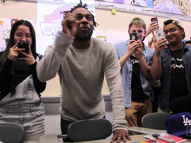 Kendrick Lamar joins high school kids in a rap lesson