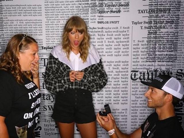 Taylor Swift is the 3rd wheel in a marriage proposal